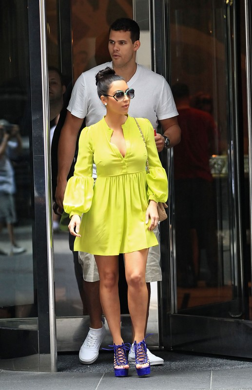 Kim Kardashian goes shopping in SoHo, NYC in a beautiful yellow dress with Kris Humphries.  Pictured: Kim Kardashian and Kris Humphries