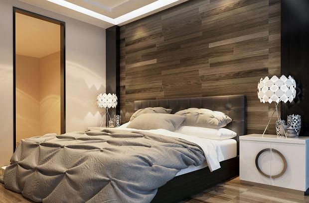 Panele podłogowe na ścianie za łóżkiem