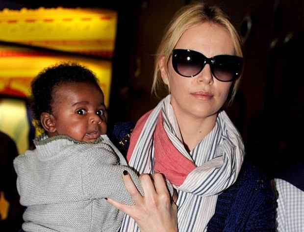 South African actress Charlize Theron with her adopted baby are spotted upon arrival at Roissy Charles De Gaulle international airport, near Paris, France on May 8, 2012. Photo by ABACAPRESS.COM  # 319395_017