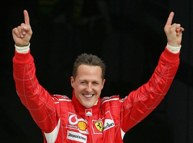 Ferrari Formula One driver Michael Schumacher of Germany celebrates after taking the pole position at the end of the qualifying session for the Bahrain Formula One Grand Prix at the Sakhir racetrack in Manama in this March 11, 2006 file picture. Seven-times Formula 1 motor racing world champion Michael Schumacher, who suffered serious head injuries in a December skiing accident, is making progress and showing signs of waking from an artificial coma, his agent said on April 4, 2014.  REUTERS/Caren Firouz/Files (BAHRAIN - Tags: SPORT MOTORSPORT)