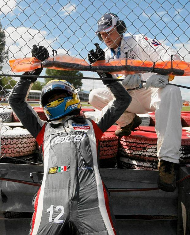 Sauber Formula One driver Esteban Gutierrez of Mexico climbs through a fence after crashing during the Canadian F1 Grand Prix at the Circuit Gilles Villeneuve in Montreal June 9, 2013. REUTERS/Christinne Muschi (CANADA  - Tags: SPORT MOTORSPORT F1)   SLOWA KLUCZOWE: :rel:d:bm:TB3E9691LYLAQ