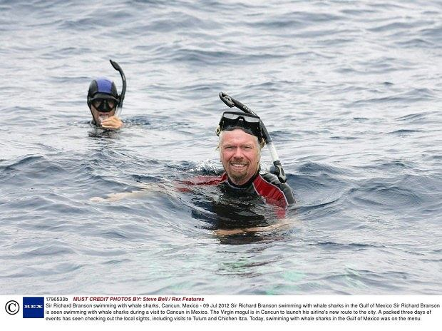 Mandatory Credit: Photo by Steve Bell / Rex Features (1796533b)  Sir Richard Branson swimming with whale sharks in the Gulf of Mexico  Sir Richard Branson swimming with whale sharks, Cancun, Mexico - 09 Jul 2012  Sir Richard Branson is seen swimming with whale sharks during a visit to Cancun in Mexico. The Virgin mogul is in Cancun to launch his airline's new route to the city. A packed three days of events has seen checking out the local sights, including visits to Tulum and Chichen Itza. Today, swimming with whale sharks in the Gulf of Mexico was on the menu.