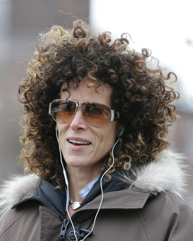 Andrea Constand, who accuses Bill Cosby of sexually assaulting her, walks in a park in Toronto, December 30, 2015. Cosby, who cultivated a father-figure image over decades, was charged on Wednesday with sexually assaulting a woman at his home in 2004 in the first criminal case against the comedian accused of misconduct by dozens of women. The accuser in the case, Constand, a former basketball team manager at Temple University in Philadelphia, Cosby's alma mater, is one of more than 50 women who have publicly accused Cosby of sexually assaulting them in incidents dating back decades.   REUTERS/Mark Blinch