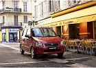 SUZUKI Wagon R+ 03-05, rok produkcji 2003, kombi, widok przedni prawy, samochód 5-drzwiowy, kolor czerwony jasny