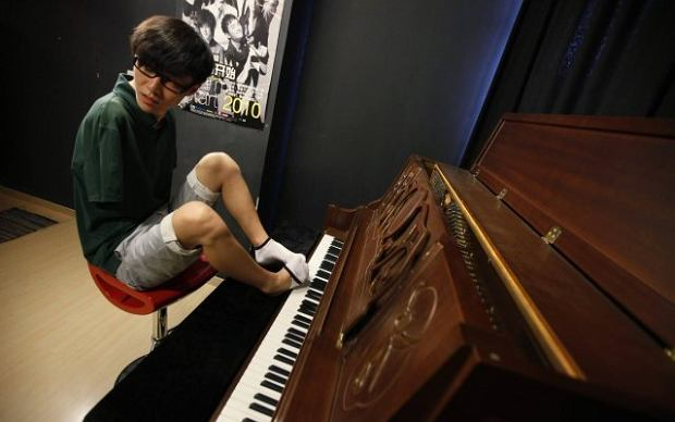 "Pianista bez r�k w chi�skim ""Mam talent"". Wideo"