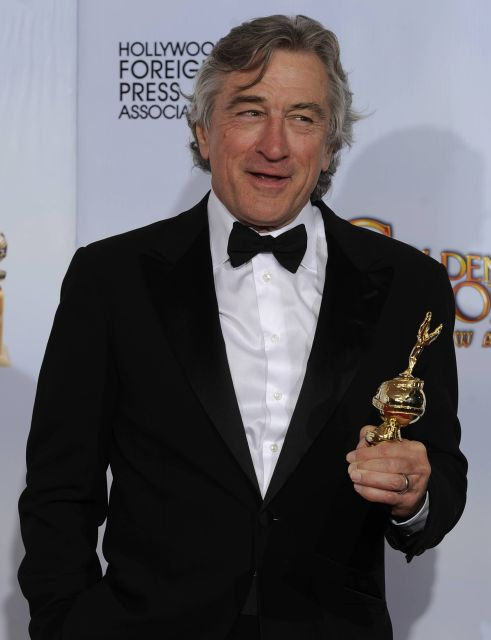 Robert DeNiro holds the Cecil B. DeMille Award that he received at the Golden Globe Awards Sunday, Jan. 16, 2011, in Beverly Hills, Calif. (AP Photo/Matt J. Terrill)