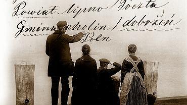 Emigranci na portowym nabrzeżu. Stacja migracyjna Ellis Island, Nowy Jork, 1912