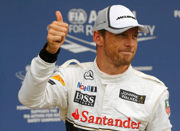 McLaren Formula One driver Jenson Button of Britain gestures after qualifying in third place ahead of the British Grand Prix at the Silverstone Race Circuit, central England, July 5, 2014. REUTERS/Phil Noble (BRITAIN - Tags: SPORT MOTORSPORT F1) SLOWA KLUCZOWE: :rel:d:bm:GF2EA7510YG01