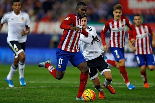 Atletico Madrid's Jackson Martinez, left, vies for the ball with Valencia's Jose Gaya during the Spanish La Liga soccer match between Atletico Madrid and Valencia at the Vicente Calderon stadium in Madrid, Sunday, Oct. 25, 2015. Martinez scored once in Atletico's 2-1 victory. (AP Photo/Francisco Seco)
