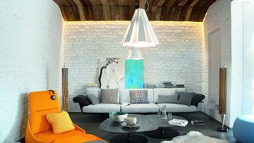 W części wypoczynkowej strefy dziennej sofa firmy Arper. Lampy spódniczki marki Delta Light zaprojektował Tim Van Steenbergen. Obraz Mariusza Andryszczyka.