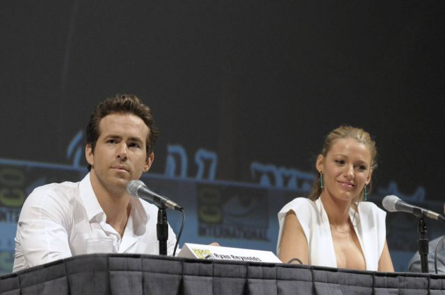 "Actor Ryan Reynolds, left, and actress Blake Lively speak at a panel discussion of their feature film ""Green Lantern"" at Comic Con in San Diego, Calif. on Saturday, July 24, 2010. (AP Photo/Dan Steinberg)"