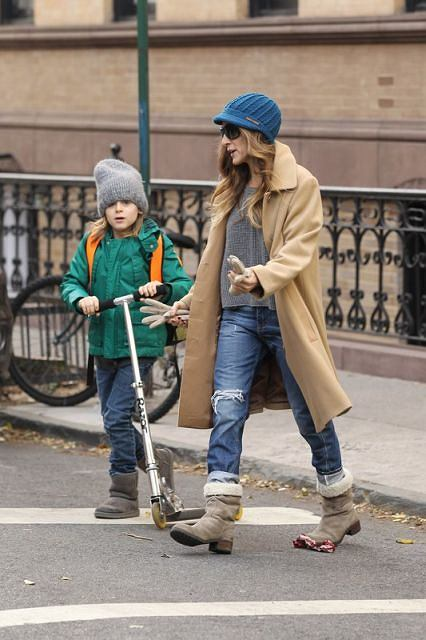 Actress Sarah Jessica Parker, wearing a camel hair coat, ripped jeans, a blue beanie cap and suede boots, walks her son James Wilkie Broderick to school in the West Village, New York City.  Pictured: Sarah Jessica Parker and James Broderick