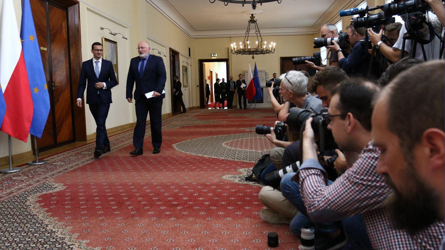 Premier Mateusz Morawiecki i wiceszef KE Frans Timmermans
