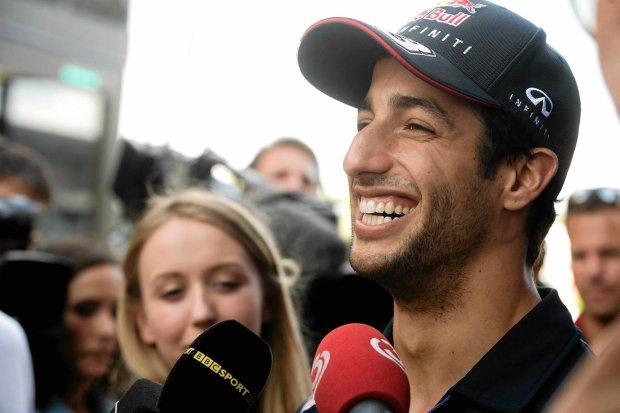 Australian Daniel Ricciardo of Red Bull is interviewed on the Hungaroring circuit  near Budapest, Hungary, Thursday, July 24, 2014, three days ahead of the Formula One Hungarian Grand Prix. (AP Photo/MTI, Szilard Koszticsak)