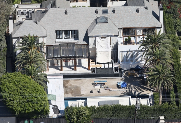 Aerial photos Simon Cowell who is renovating his million dollar brand new mansion. It looks like he is renovating the pool and adding balconies on October 2, 2011. X17online.com *** Local Caption ***  Simon Cowell