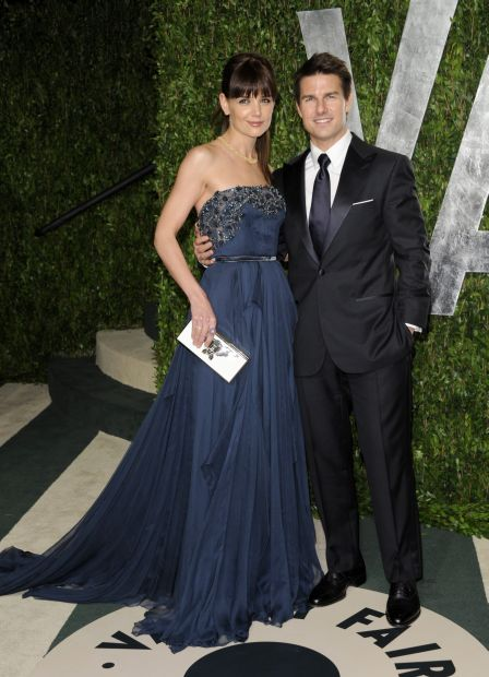Katie Holmes, left, and Tom Cruise arrive at the Vanity Fair Oscar party on Sunday, Feb. 26, 2012, in West Hollywood, Calif. (AP Photo/Evan Agostini)