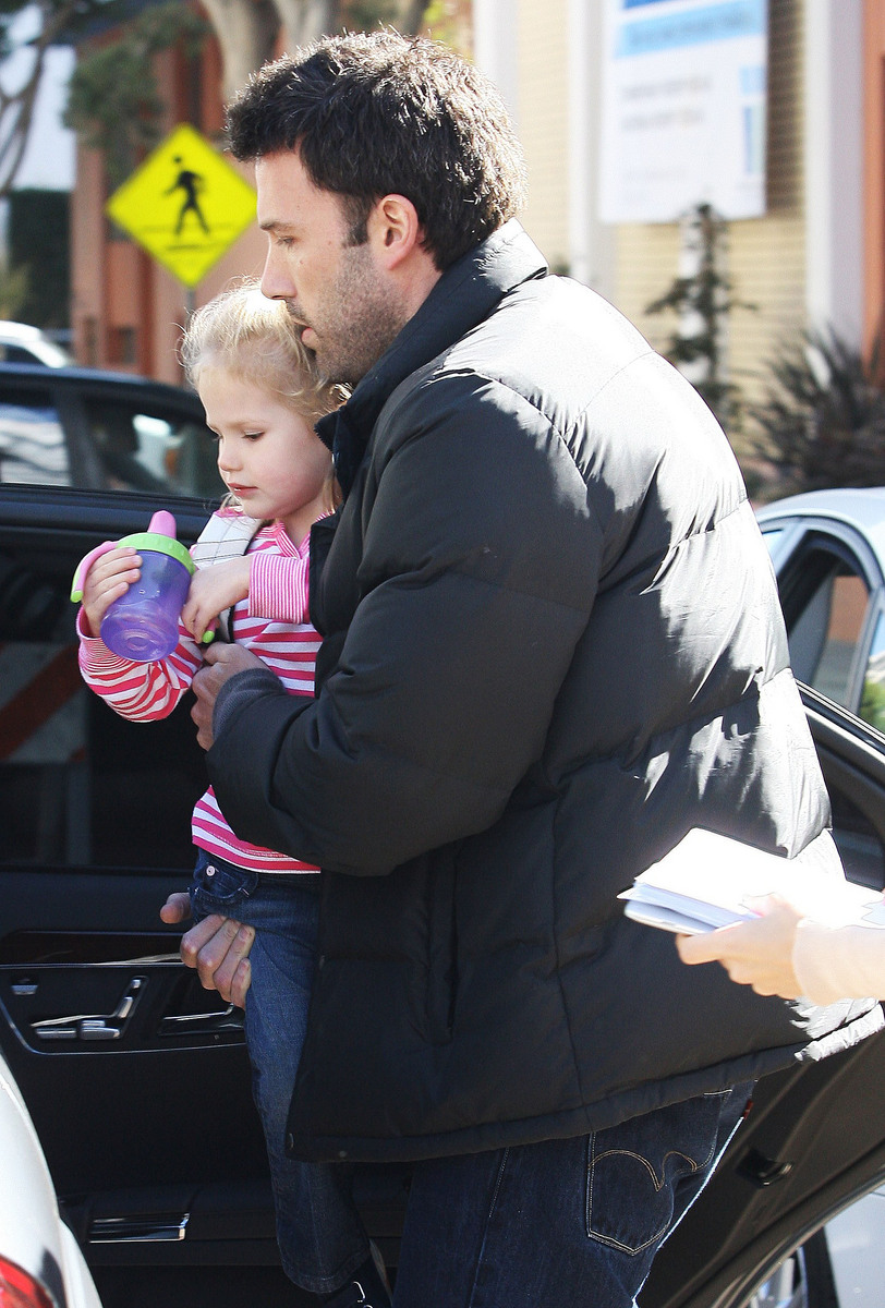 Proud dad Ben Affleck performs his duties, as he picks up daughter Violet from school in Santa Monica. Violet seems to be hooked with the latest gadgets as daddy Ben carries up her Apple computer.