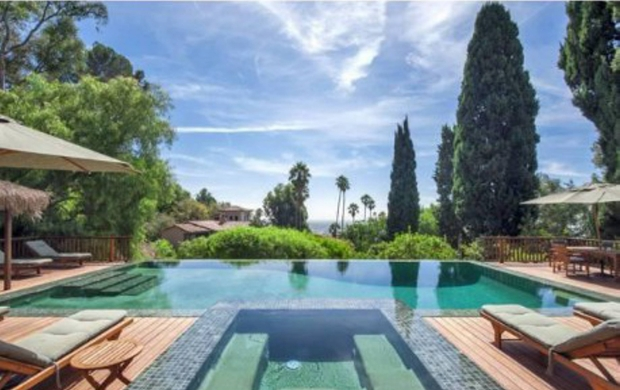 MAVRIXONLINE.COM - It's reported that Sheryl Crow, who was recently diagnosed with a brain tumor, has listed her gated 11-acre compound in the Hollywood Hills with an asking price of $15.4 million. According to the reports, the compound includes three homes: a restored 1925 Spanish Revival main house with 5,437 square feet, 4 bedrooms and 3.5 bathrooms; a restored cottage built in 1885 that includes 1,334 square feet, 2 bedrooms and 2 bathrooms; and a 1909 Craftsman with 3,335 square feet and 3 bedrooms and 3 bathrooms. The main home includes a double height foyer, step-down living room with vintage tiles, a library and half-vintage, half-modernized eat-in kitchen. The cottage is connected to the main home by a Brazilian Ironwood bridge that spans the driveway. Just above it is a negative-edge swimming pool and spa surrounded by decks. Above the pool area is the Craftsman home that features living and dining rooms, restored vintage appliances and other vintage fittings and a television viewing room. Crow purchased the main home in 1998 for $1.8 million and later that year purchased the other two homes for $3.3 million. Los Angeles, CA. 1st October 2012.  Photos courtesy of Realtor.com.  Byline, credit, TV usage, web usage or linkback must read MAVRIXONLINE.COM/REALTOR.COM.  Failure to byline correctly will incur double the agreed fee.  Tel: +1 305 542 9275.