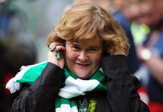 FILE - Susan Boyle performs ahead of the Champions League qualifying second round soccer match between Celtic and Helsingborgs at Celtic Park, Glasgow, Scotland, in this Aug. 29, 2012 file photo. Boyle told the Observer newspaper in an interview published Sunday Dec. 8, 2013, she has been diagnosed with Asperger's syndrome, a form of autism, after seeing a specialist a year ago. (AP Photo/Scott Heppell, File)