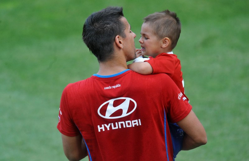 Czech Republic's Milan Baros comforts his son Patrik during a training session of the Czech National soccer team on May 31, 2012, in Prague. AFP PHOTO / MICHAL CIZEK