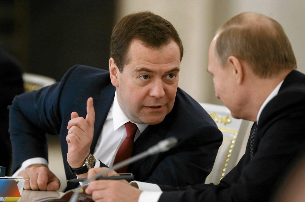 Russian President Vladimir Putin and Russian Prime Minister Dmitry Medvedev, left, talk during the meeting of the State Council in Moscow's Kremlin, Russia, on Wednesday, Dec. 24, 2014. The meeting of the State Council focused on government efforts to support culture. (AP Photo/RIA Novosti, Alexei Druzhinin, Presidential Press Service)