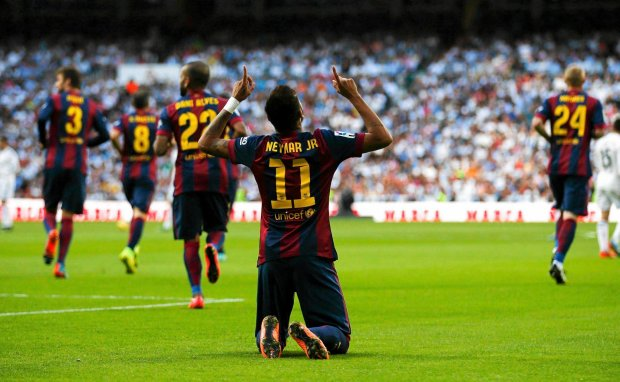 """Barcelona's Neymar celebrates after scoring against Real Madrid during their Spanish first division """"Clasico"""" soccer match at the Santiago Bernabeu stadium in Madrid October 25, 2014.     REUTERS/Sergio Perez (SPAIN  - Tags: SOCCER SPORT)   SLOWA KLUCZOWE: :rel:d:bm:LR1EAAP1CJTYP"""