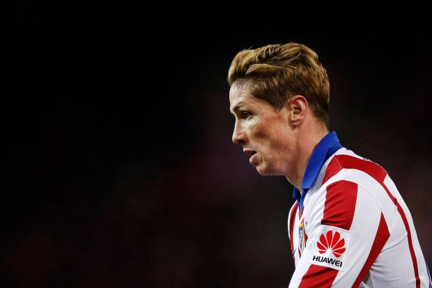 Atletico de Madrid player Fernando Torres reacts during a second leg quarterfinal Copa del Rey soccer match between Atletico de Madrid and FC Barcelona at the Vicente Calderon stadium in Madrid, Spain, Wednesday, Jan. 28, 2015 . (AP Photo/Daniel Ochoa de Olza)