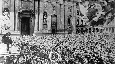 Wielu Europejczyków cieszyło się z wybuchu wojny tak jak ci monachijczycy sfotografowani na Odeonsplatz przed Feldherrnhalle, bramą-pomnikiem ku czci wybitnych wodzów armii bawarskiej. Na tym wiecu był też 25-letni Adolf Hitler (w kółku), który z wielkim entuzjazmem przywitał wybuch wojny i zaciągnął się do wojska bawarskiego.