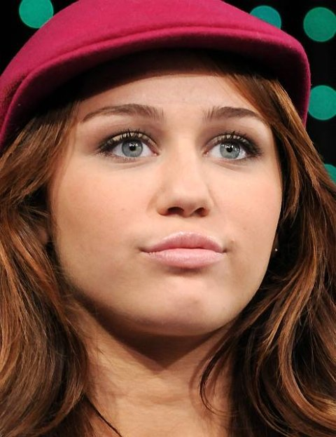 """Actress-singer Miley Cyrus   co-hosts MTV's """"Total Request Live"""" at MTV Studios on Friday, July 18, 2008 in New York. Her  taped appearance will air Thursday,July 24. (AP Photo/Evan Agostini)"""