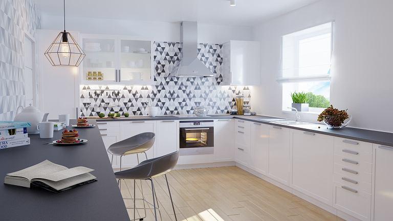 Dużo światła, zarówno naturalnego i sztucznego, białe meble i drewniane dodatki - to główne cech kuchni w stylu skandynawskim.
