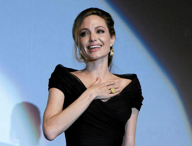 FILE - This Feb. 14, 2012 file photo shows US actress and director Angelina Jolie addressing the audience after premiere of her movie,