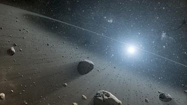 Artystyczna wizja asteroid za orbitą Neptuna (w tzw. pasie Kuipera)