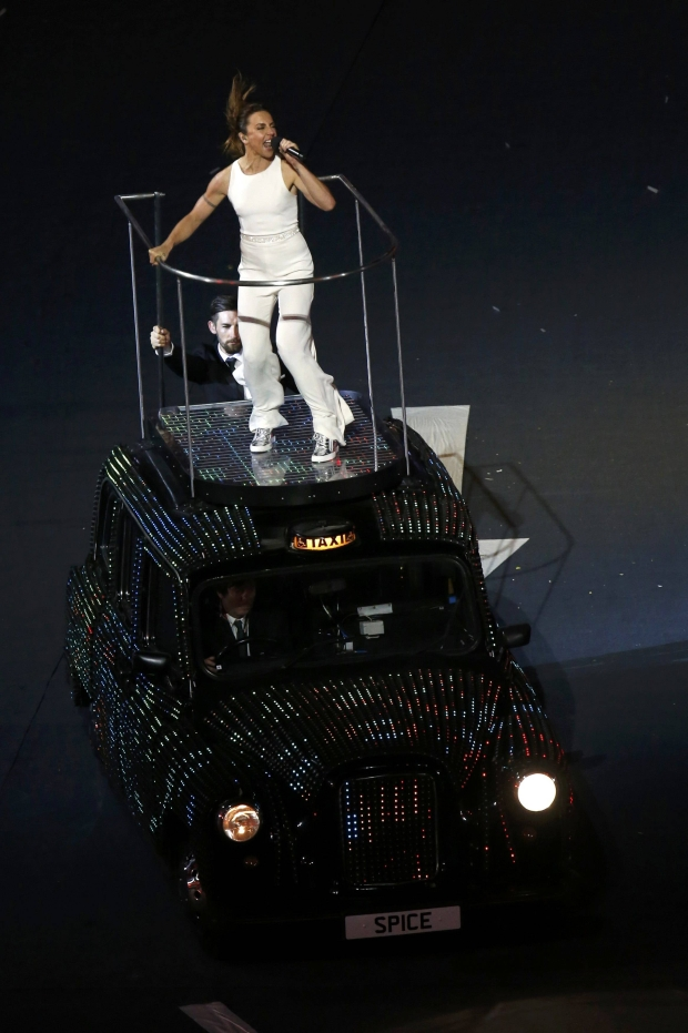 Melanie Chisholm of British pop group Spice Girls performs on top of a London taxi during the closing ceremony of the London 2012 Olympic Games at the Olympic Stadium August 12, 2012.            REUTERS/Luke Macgregor (BRITAIN  - Tags: OLYMPICS SPORT ENTERTAINMENT)