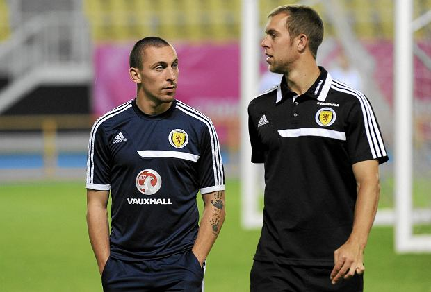 Scotland's national soccer team captain Scott Brown, left, talks with teammate Steven Whittaker on the pitch at Philip II Arena in Macedonia's capital Skopje on Monday, Sept. 9, 2013, ahead of Tuesday's Group A World Cup qualifier against Macedonia. (AP Photo/Boris Grdanoski) SLOWA KLUCZOWE: XWCUPEUROPEX