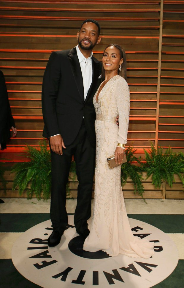 Actor Will Smith and his wife Jada Pinkett Smith arrive at the 2014 Vanity Fair Oscars Party in West Hollywood, California March 2, 2014. REUTERS/Danny Moloshok (UNITED STATES TAGS: ENTERTAINMENT) (OSCARS-PARTIES)