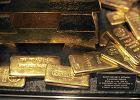 Złoto spada poniżej psychologicznego poziomu 1,2 tys. dol. za uncję