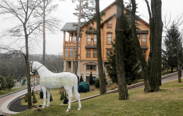 A view of Ukrainian President Yanukovych's countryside residence in Mezhyhirya, Kiev's region, Ukraine, Saturday, Feb, 22, 2014. Viktor Yanukovych is not in his official residence of Mezhyhirya, which is about 20 km (12.5 miles) north of the capital. Ukrainian security and volunteers from among Independence Square protesters have joined forces to protect the presidential countryside retreat from vandalism and looting. Yanukovych left Kiev for his support base in the country's Russian-speaking east, but an aide said that he has no intention of abandoning power. (AP Photo/Efrem Lukatsky)