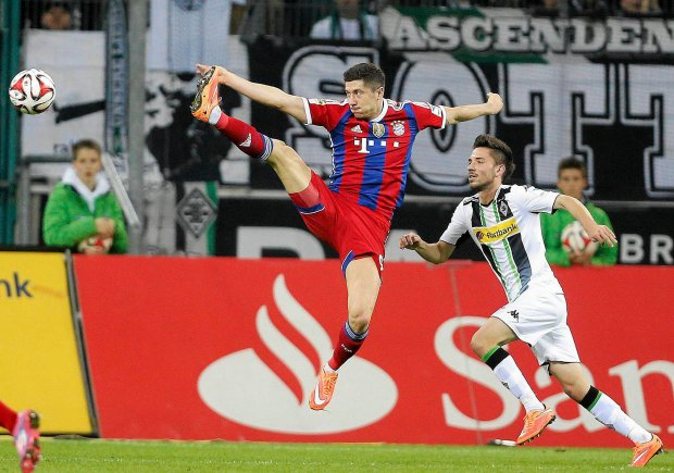 Bayern's Robert Lewandowski from Poland jumps for the ball during the German first division Bundesliga soccer match between Borussia Moenchengladbach and Bayern Munich in Moenchengladbach, Germany, Sunday, Oct. 26, 2014. (AP Photo/Frank Augstein)