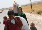 Zach�d zbroi Kurd�w i ratuje jazyd�w przed masakr�