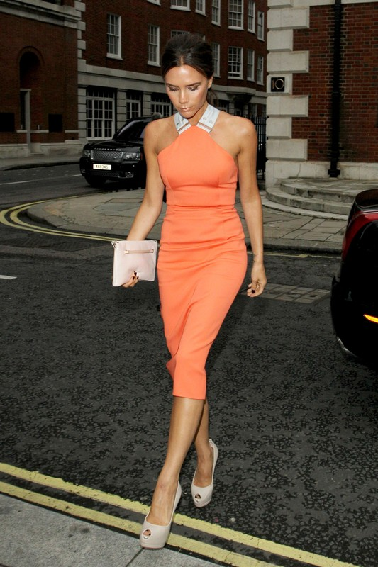 80774, LONDON, UNITED KINGDOM - Monday July 9 2012. David and Victoria Beckham are joined by other celebrities to celebrate Simon Fuller's birthday at Roland Mouret in London. Victoria is dressed in a figure-hugging orange dress and sky-high nude heels, while Becks dons a crisp black suit. Photograph: ? PacificCoastNews.com **FEE MUST BE AGREED PRIOR TO USAGE** **E-TABLET/IPAD & MOBILE PHONE APP PUBLISHING REQUIRES ADDITIONAL FEES** LOS ANGELES OFFICE: 1 310 822 0419 LONDON OFFICE: +44 208 090 4079