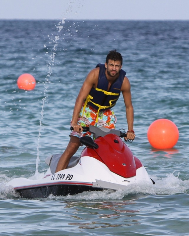 Gerard Pique jet skiing in Miami beach. Gerard was seeing friends without Shakira who is currently on tour in Mexico.  Pictured: Gerard Pique