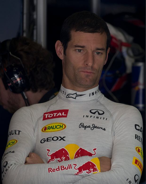 Red Bull driver Mark Webber of Australia waits at the rear of his garage during the first practice session for the Chinese Formula One Grand Prix in Shanghai, China, Friday, April 12, 2013. (AP Photo/Ng Han Guan)