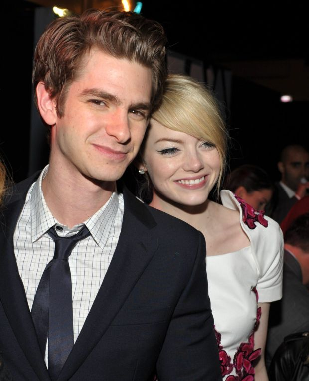 """Andrew Garfield, left, and Emma Stone attend the party for the world premiere of """"The Amazing Spider-Man"""" at the Regency Village Theatre on Thursday, June 28, 2012 in Los Angeles. (Photo by John Shearer/Invision/AP)"""