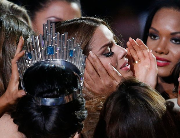 Other contestants comfort Miss Colombia Ariadna Gutierrez, center right, after she was incorrectly crowned Miss Universe at the Miss Universe pageant Sunday, Dec. 20, 2015, in Las Vegas. According to the pageant, a misreading led the announcer to read Miss Colombia Ariadna Gutierrez as the winner before they took it away and gave it to Miss Philippines Pia Alonzo Wurtzbach, pictured on left. (AP Photo/John Locher)
