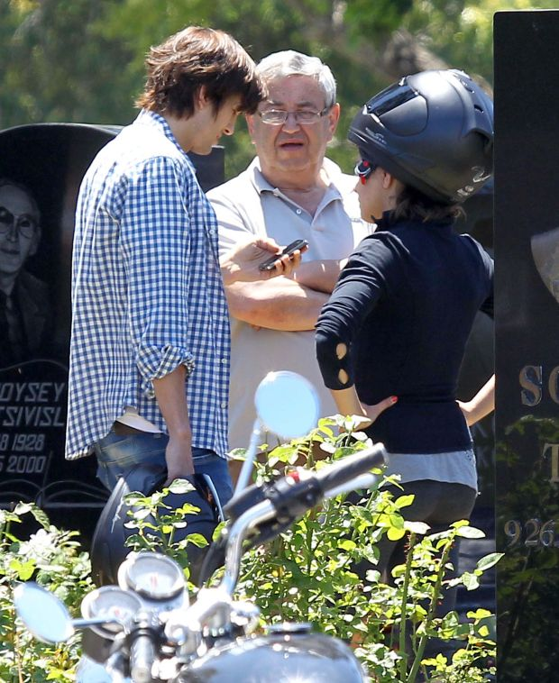 *EXCLUSIVE* Hollywood, CA - Ashton Kutcher and Mila Kunis visit Hollywood Forever cemetery today in honor of Mila's grandmother's death anniversary and were accompanied by Mila's family members.  The pair arrived on Ashton's motorcycle and Mila kept her helmet on for most of the time while Ashton held his in his hand.  After the couple chatted with Mila's family they took off on Ashton's bike with Mila cuddling up behind him.  In the last couple of weeks the pair have been spending a lot more time together as they had lunch at the Soho House, showing some PDA and spending Fourth of July together as well.  It looks as though the long time friends have been getting a lot closer these days and might as well own up to the dating rumors!      AKM-GSI          July 8, 2012      To License These Photos, Please Contact :    Steve Ginsburg  (310) 505-8447  (323) 4239397  steve@ginsburgspalyinc.com  sales@ginsburgspalyinc.com    or    Keith Stockwell  (310) 261-8649  (323) 325-8055   keith@ginsburgspalyinc.com  ginsburgspalyinc@gmail.com *** Local Caption ***  Mila Kunis and Ashton