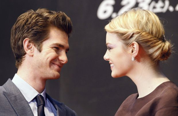 """Cast members Andrew Garfield (L) and Emma Stone attend the world premiere of """"The Amazing Spider-Man"""" in Tokyo June 13, 2012. REUTERS/Yuriko Nakao (JAPAN - Tags: ENTERTAINMENT SOCIETY)"""
