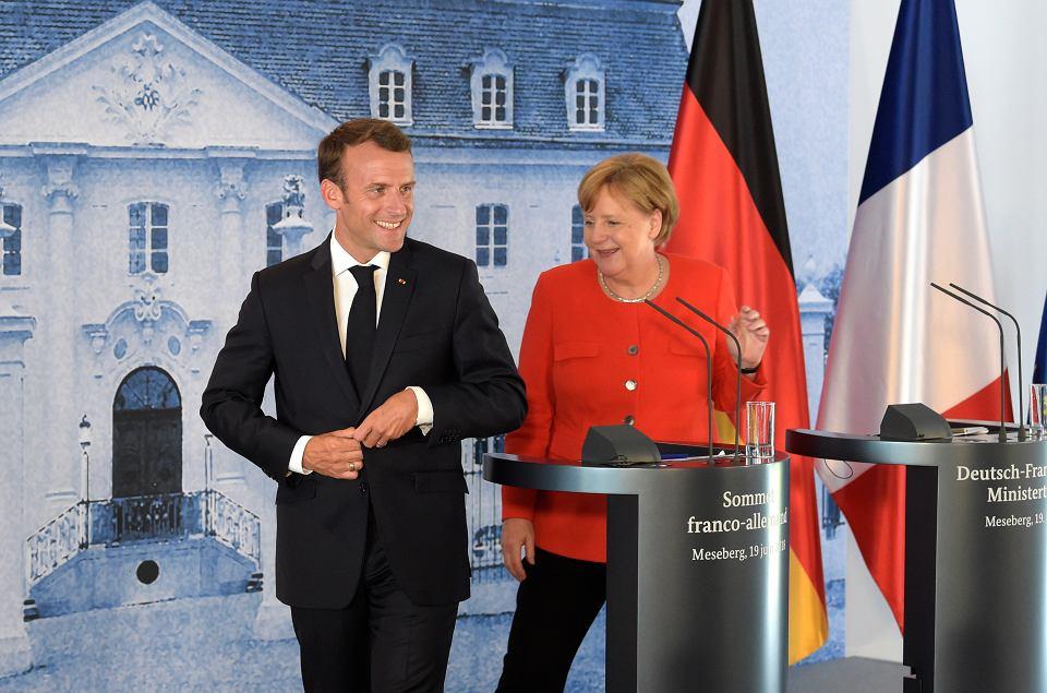 Prezydent Francji Emmanuel Macron i kanclerz Angela Merkel tuż po konferencji prasowej w rządowym pałacyku Meseberg pod Berlinem, 19 czerwca 2018 r.