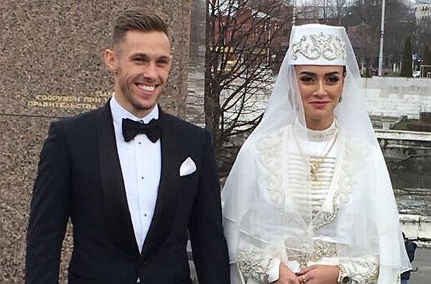 Maciej Rybus z żoną