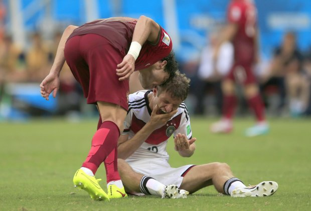 Portugal's Pepe , left, puts his head on Germany's Thomas Mueller during the group G World Cup soccer match between Germany and Portugal at the Arena Fonte Nova in Salvador, Brazil, Monday, June 16, 2014.  Pepe was red carded after this.  (AP Photo/Bernat Armangue)