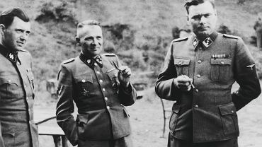 Hitlerowscy zbrodniarze Rudolf Hoess (c), dr. Mengele (l) i Josef Kramer (p)